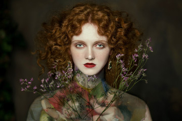 Woman with flowers in hair and renaissance body paint