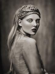 Woman posing with braided headdress, studio shot