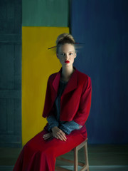 Blonde woman wearing red jacket and long skirt