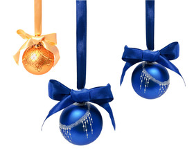 Hunging golden ahd blue christmas balls isolated