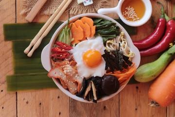 Bibimbap korean food is delicious on wood background.