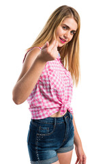 Blonde girl doing coming gesture