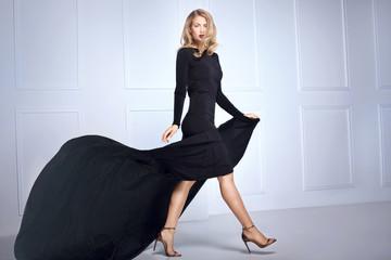 Elegant sexy woman in black dress.