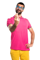 Man with colorful clothes coming gesture