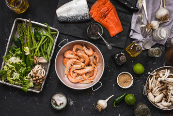 Seafood ingredients with green veggies, salmon, lagostino, green veggies, avocado, l
