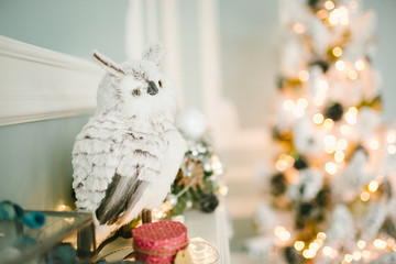Christmas decorated room with owl on fireplace