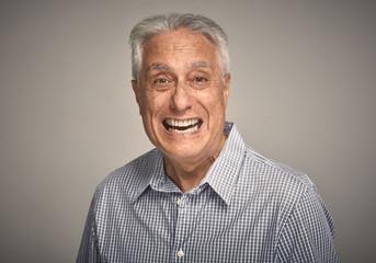 Happy smiling elderly man portrait.