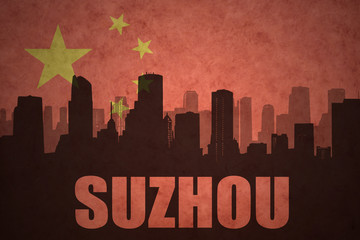 abstract silhouette of the city with text Suzhou at the vintage chinese flag background