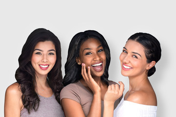 Mixed race multi-ethnic female friends having fun natural and laughing together perfect smile