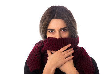 Woman hiding mouth under scarf