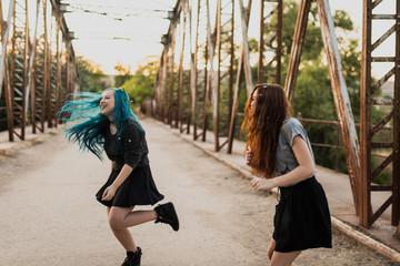 Teen girls dancing on the bridge.