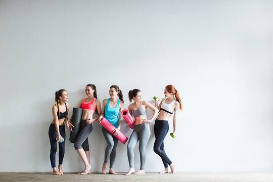 Smiling women in fitness studio.