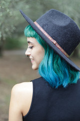 Close up of blue haired beauty looking back.