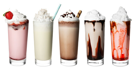 Fotobehang Milkshake Glasses with delicious milk shakes on white background.
