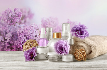 Set of body care products on flowers background
