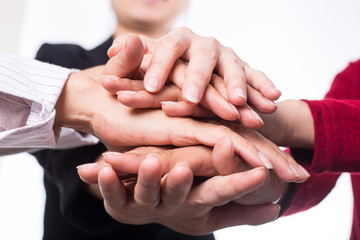 .Teamwork people touch hands for unity group