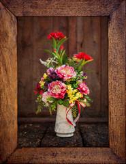 Vintage flower picture in wooden frame