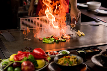 Chef preparing teppanyaki on a hot plate