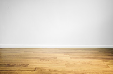 Laminated wood floor with white wall