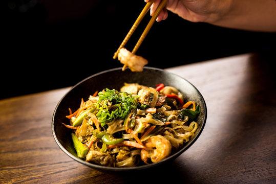 Sea food noodle in a wok.