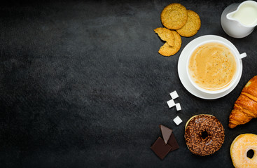 Cappuccino with Croissant and Donut on Copy Space