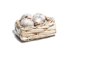 Garlic isolated on white in a basket