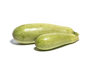 Big and small zucchini isolated on white