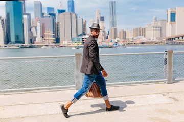 Young Fashionable Businessman Heading To Work . Manhattan Background New York City Wall mural