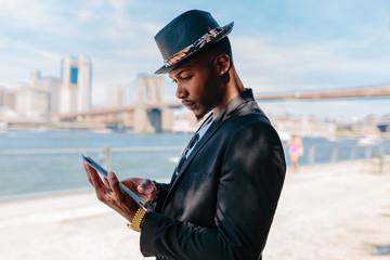 Young Black Businessman Working Outdoor . Manhattan Background New York City