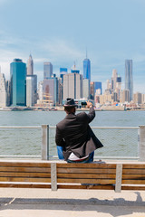 Young Black Guy Taking Picture of the Manhattan Skyline . New York City