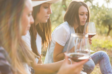 Young friends drinking red wine