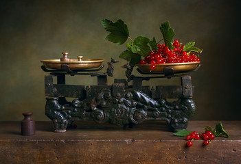 Still life with red currant on old vintage scale.