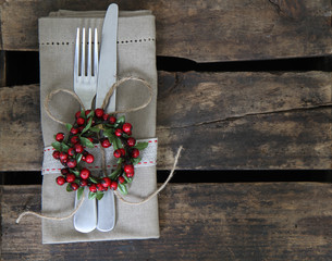 Christmas table place setting on rustic background