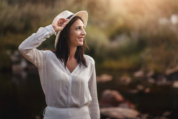 Portrait of pretty woman smiling in nature