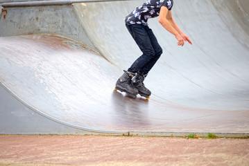 Skater falls down a ramp in Amsterdam