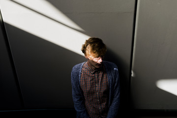 Young man between shadow and light