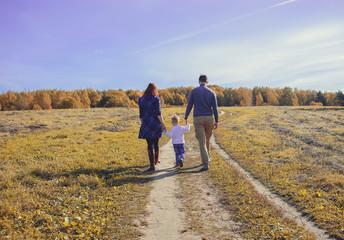 Foto op Aluminium Afrika Family holding hands go on a field.