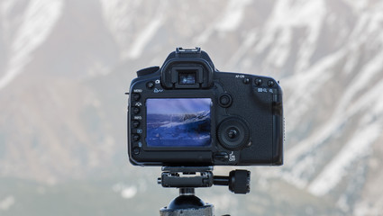 the camera photographs the mountain