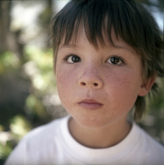 Close-up of boy with freckles