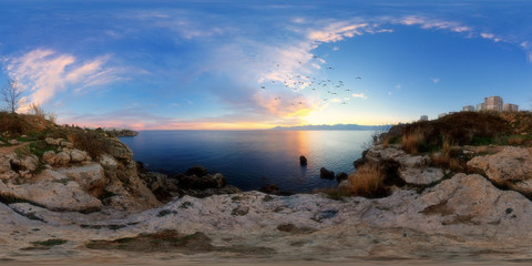 360 degree spherical panorama from Turkey, Antalya. Evening landscape with the sea, mountains, cliffs, birds and city in the background.