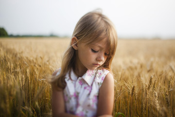 Upset girl standing against sky in farm