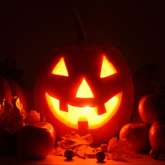 scary pumpkin head with glowing eyes - a symbol of Halloween