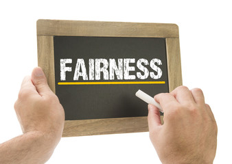 Fairness - Hand writing on chalkboard
