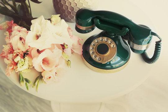 Vintage telephone on white table