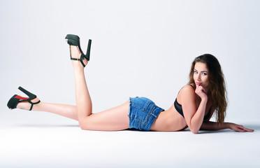 Fashion shot: sexy beautiful young girl lying on a floor