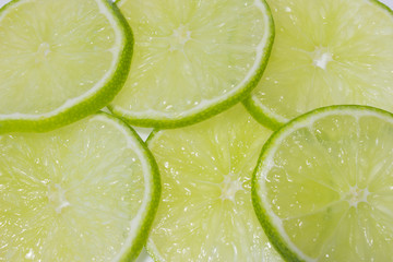 pieces of sliced of fresh ripe fruit lime