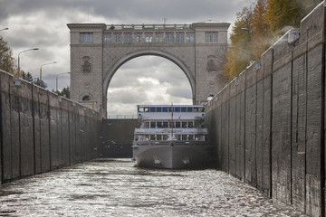Boat in navigable gateway of Uglich hydroelectric power station on river Volga, Uglich, Russia