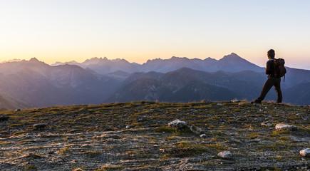 Tourist from backpacker admiring the sunrise.