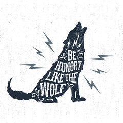 "Hand drawn Halloween label with textured wolf vector illustration and ""Be hungry like a wolf"" inspirational lettering."
