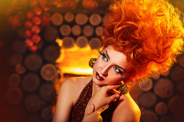 Model Girl in Autumn style at wooden fireplace background. Fashion Portrait. Creative make-up and hairstyle